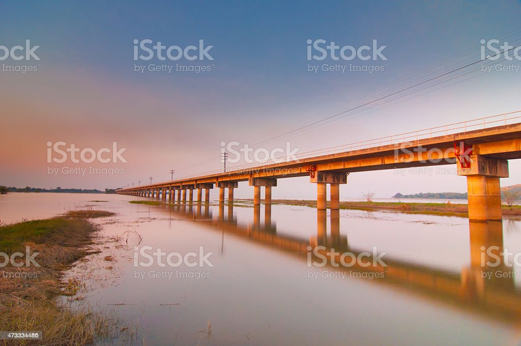 The railway bridge over the river with sunset view stock photo