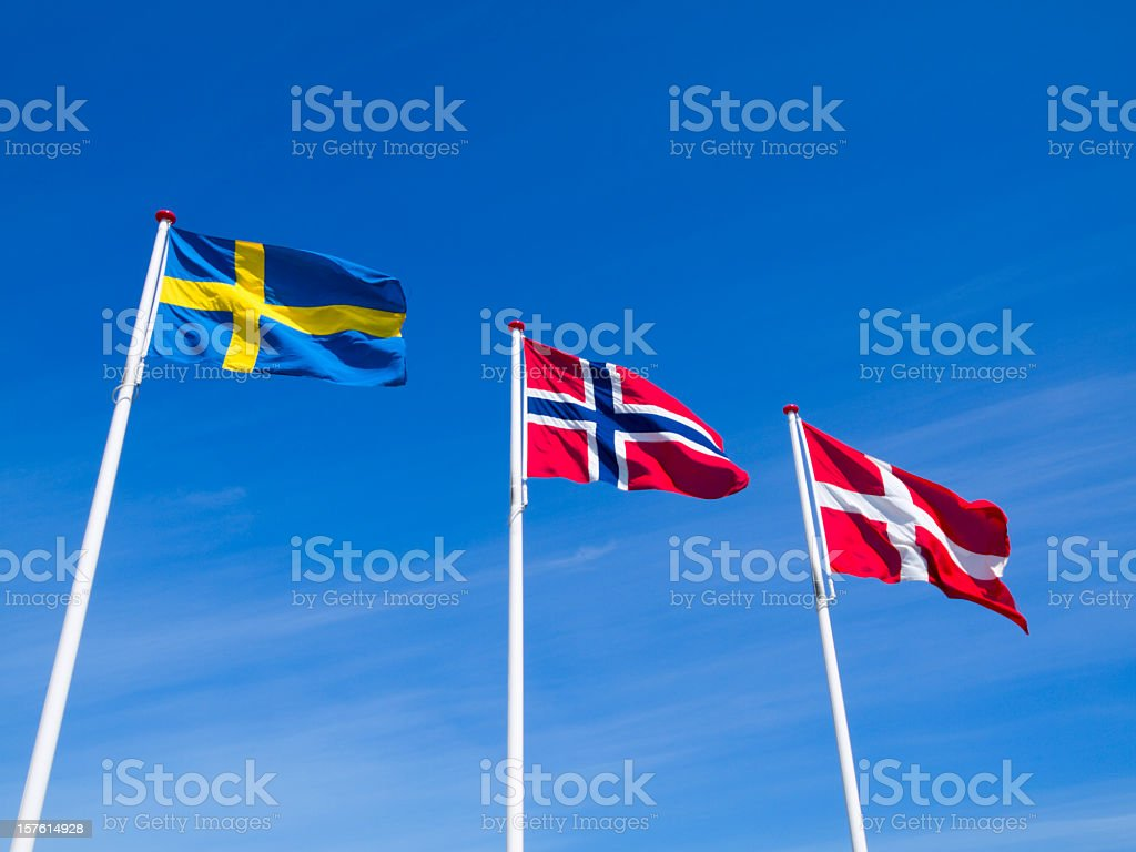 The raised flags or Norway Sweden and Denmark royalty-free stock photo