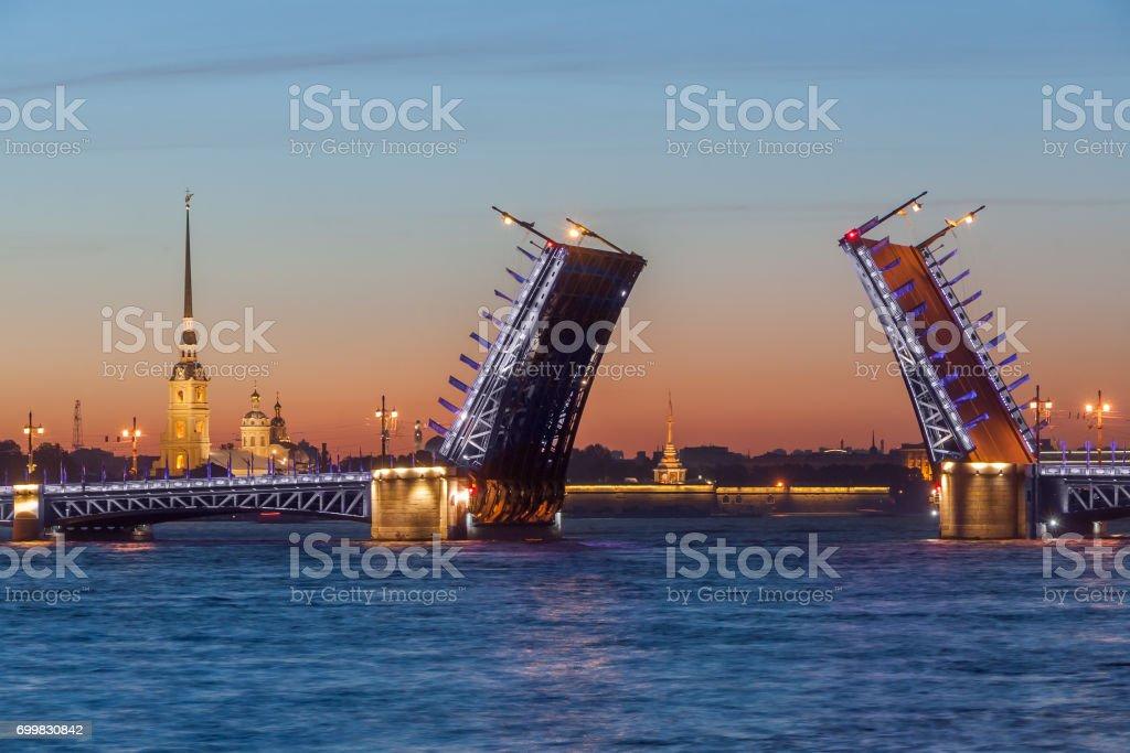 The raised Palace bridge at white nights stock photo