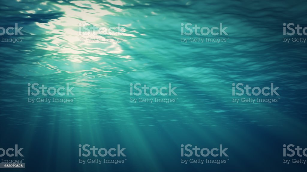 The rays of the sun make their way to the depths through the surface of the water. Underwater background. stock photo
