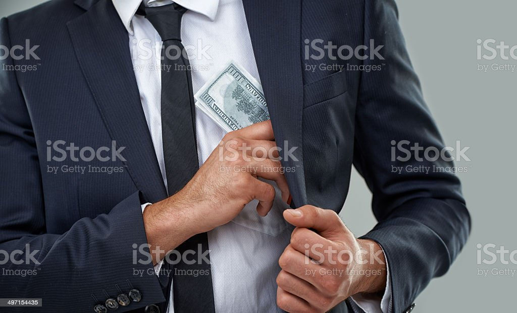 The real criminals wear suits, not ski masks... stock photo