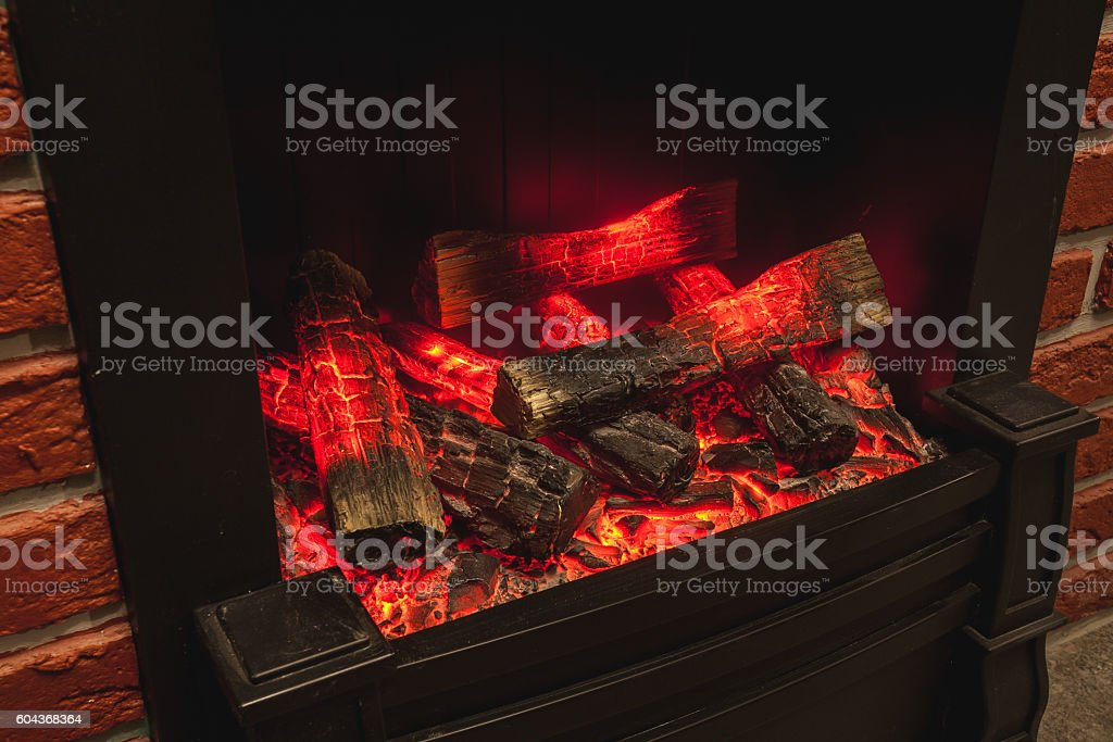 the real fireplace with the burning firewood stock photo