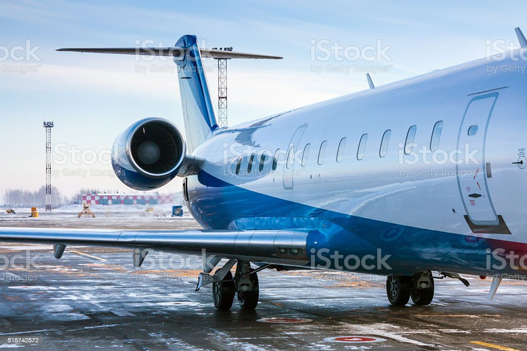 The rear of the aircraft in a cold winter airport royalty-free stock photo