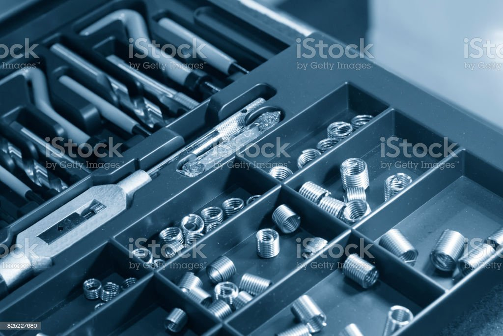 The recoil spare part for tapping repair kit in the container box. stock photo
