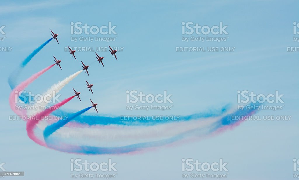The Red Arrows Colorful Smoke Trail stock photo