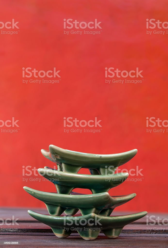 The red background with green ceramic royalty-free stock photo