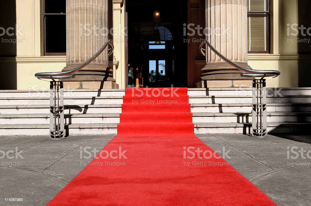 The red carpet laid out at a large stately building royalty-free stock photo