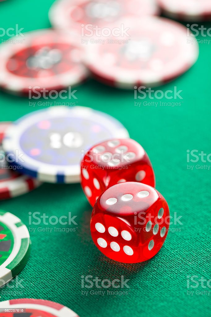 the red casino dice and casino chips stock photo
