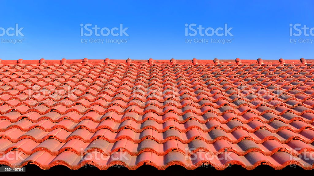 the red ceramic roof tile with sunlight stock photo
