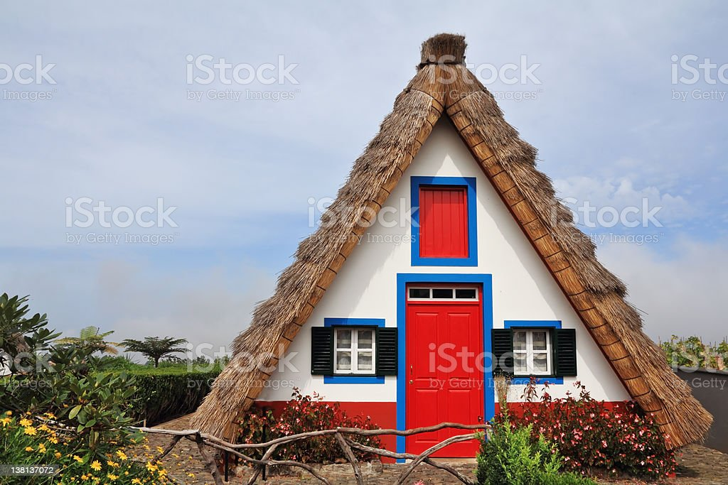 The red door and small windows royalty-free stock photo