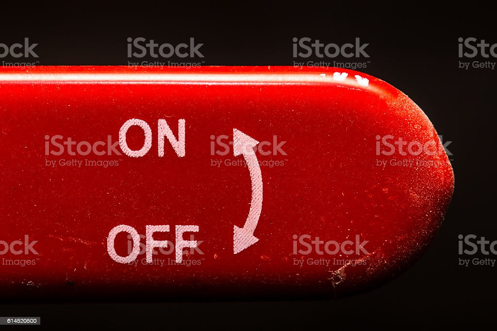 the red lever on off switch  dark background stock photo