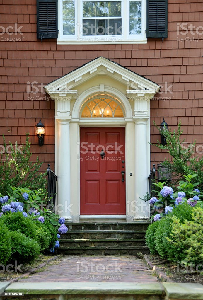 The red pillared door of a colonial design house stock photo