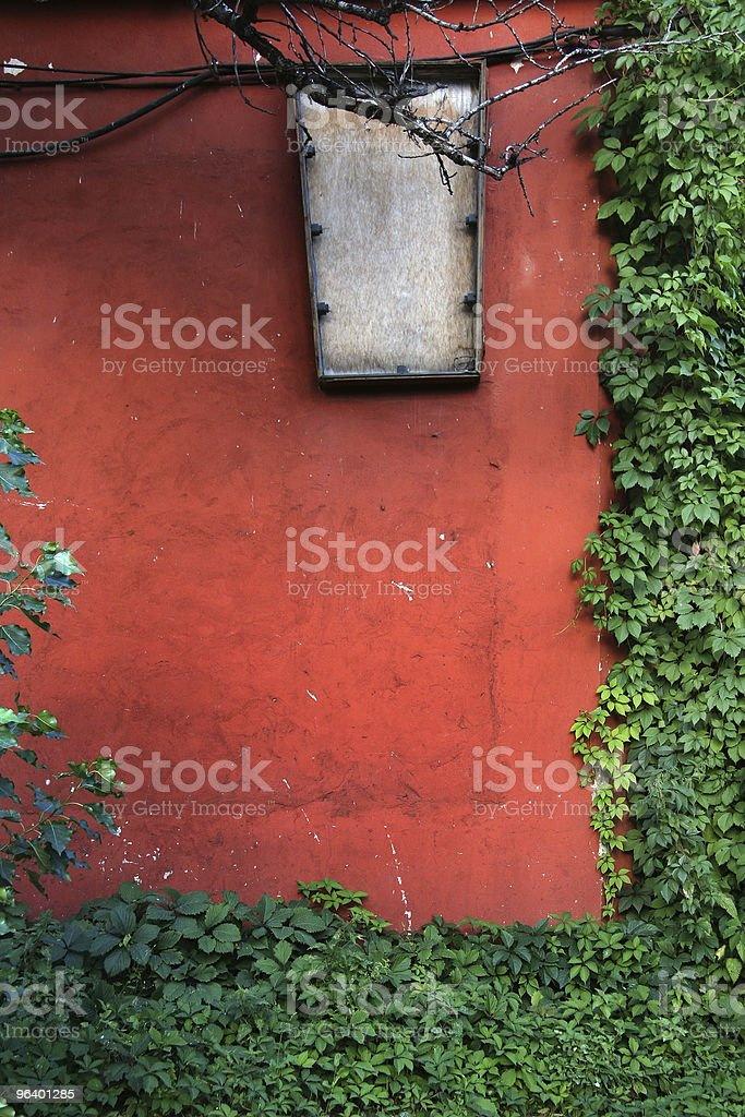 The red wall with a green frame royalty-free stock photo