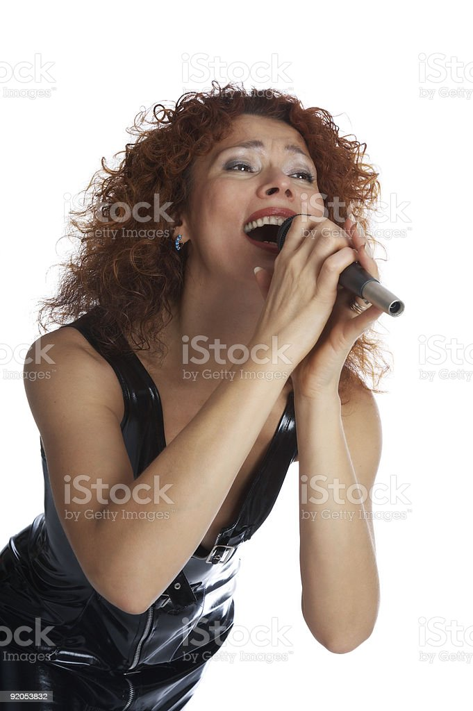 The red-haired singe in a latex dress royalty-free stock photo