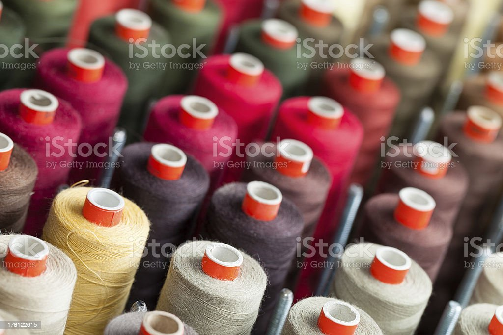 The reels with colorful threads royalty-free stock photo