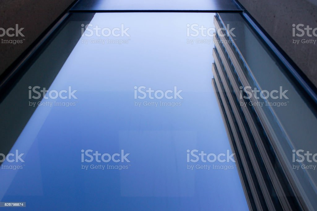 the reflection of a skyscraper in a window stock photo