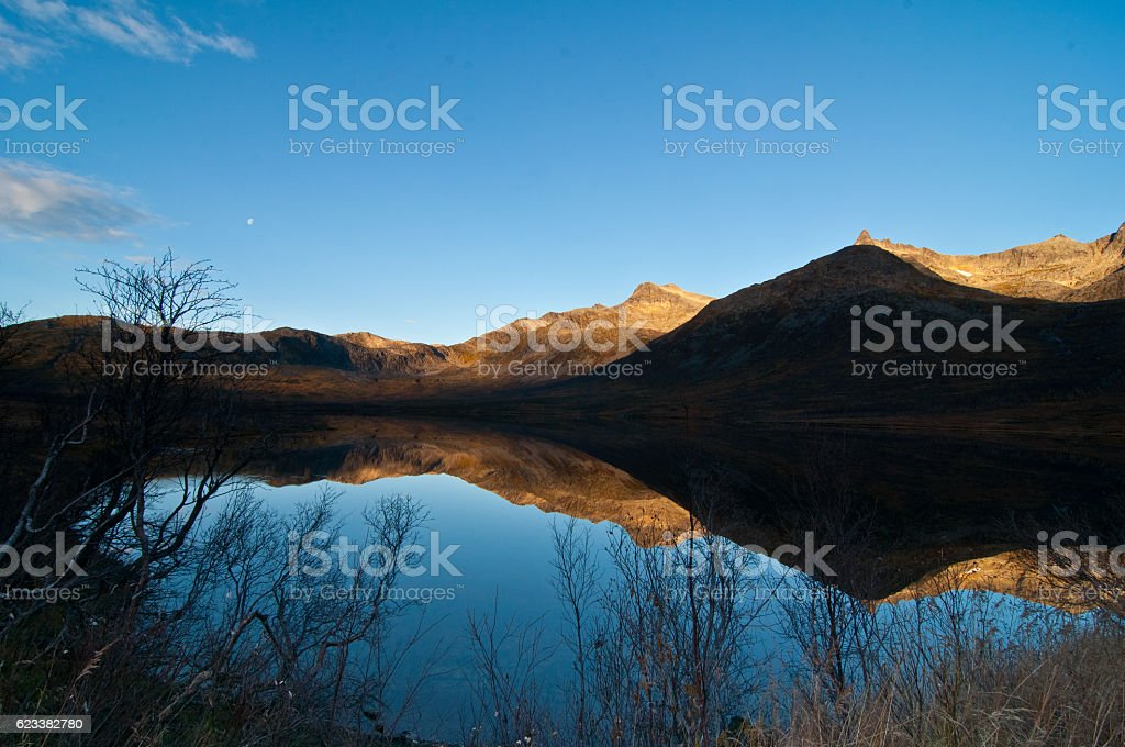 The reflection of Fjord in Norway during Autumn stock photo