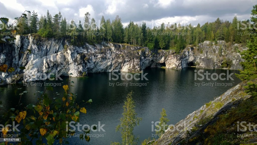 The reflection of the marble canyon in the beautiful serene lake under a cloudy sky stock photo