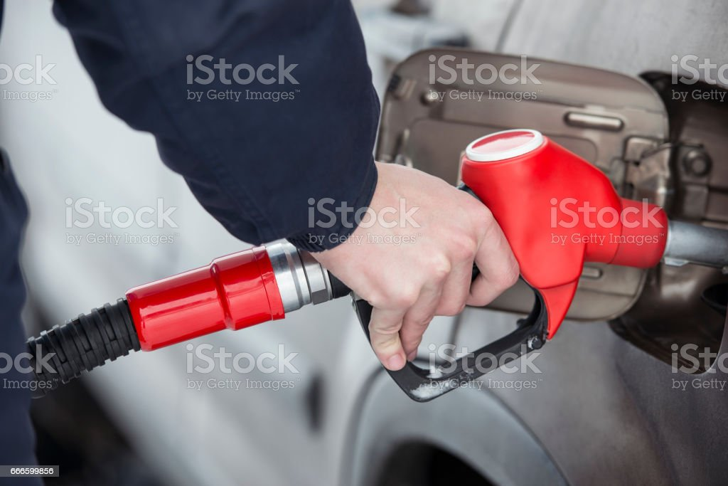 The refueling gasoline. stock photo