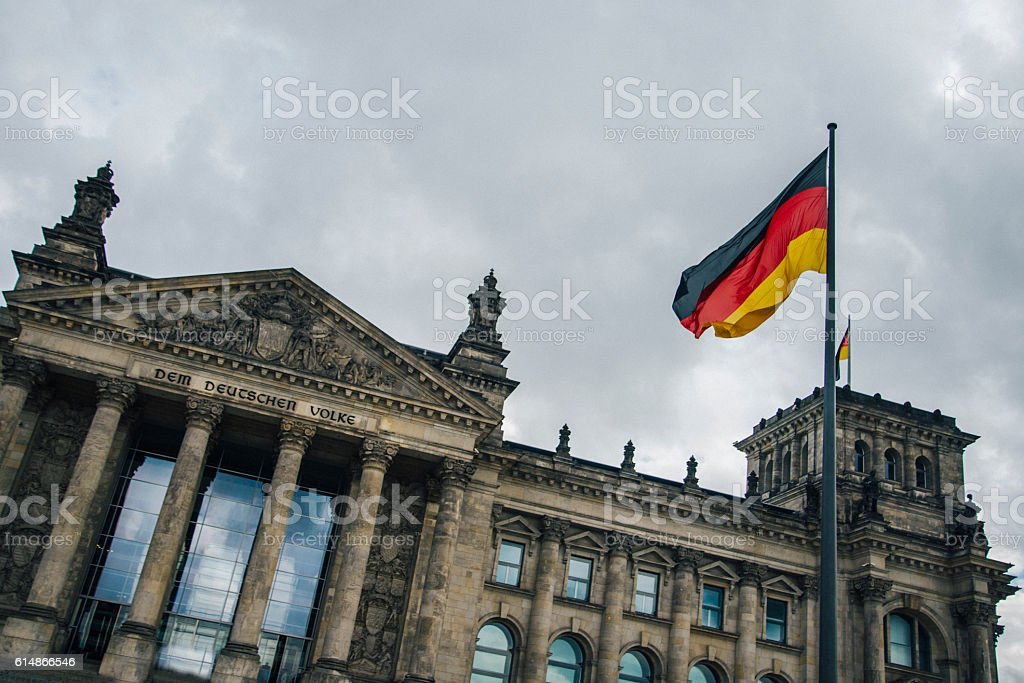 The Reichstag and German flag stock photo