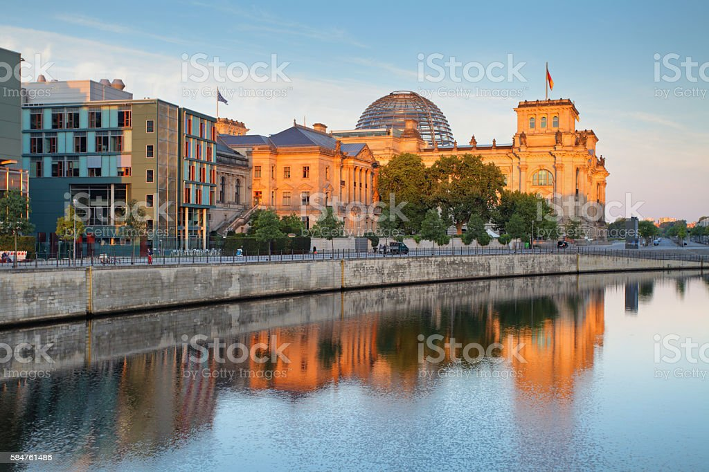 The Reichstag building (Bundestag) with reflection in river Spree stock photo