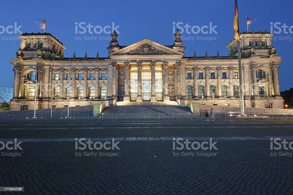 The Reichstag in Berlin at night stock photo