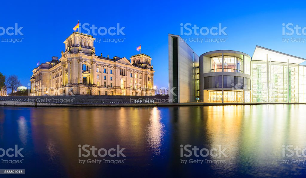 The Reichstag Parliament in Berlin at twilight, Germany stock photo