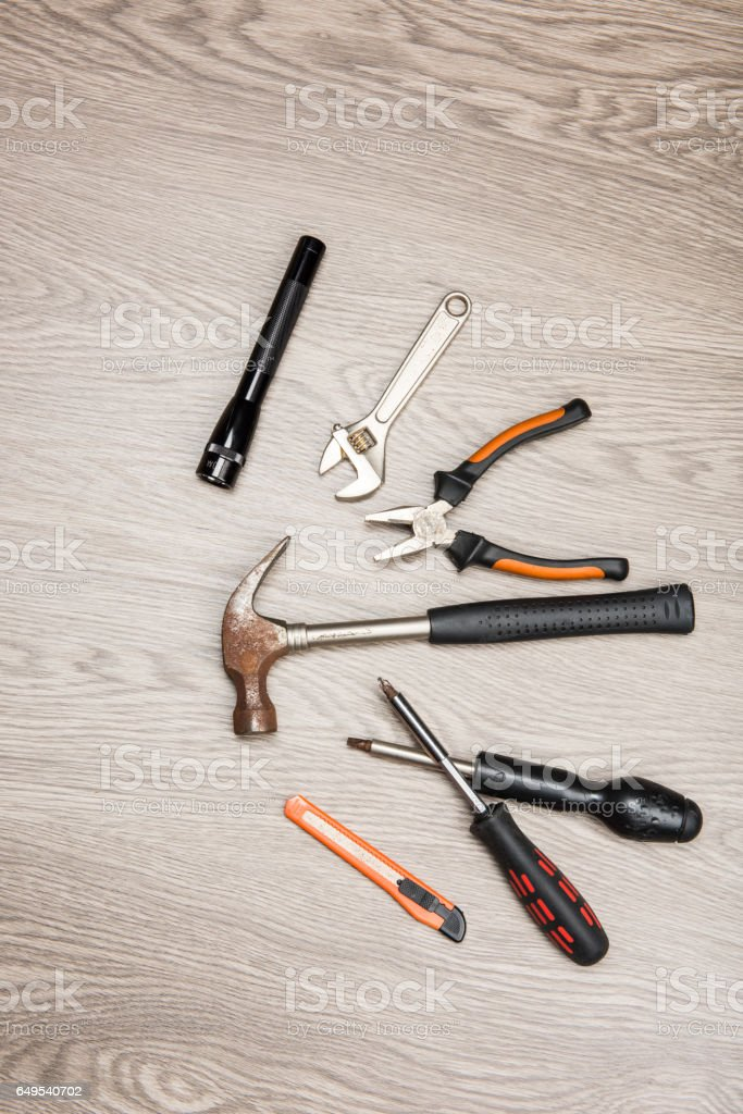 The repair tools is placed on the wooden table. stock photo