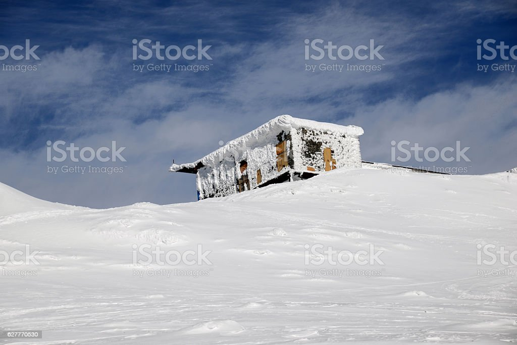 The rescue station in snowy winter mountains stock photo