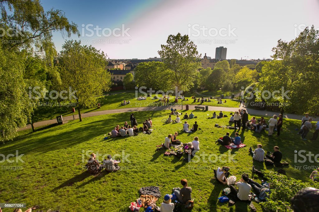 the rest of the people in Sweden are in Stockholm, center city, evening, green grass in the Park, picnic stock photo
