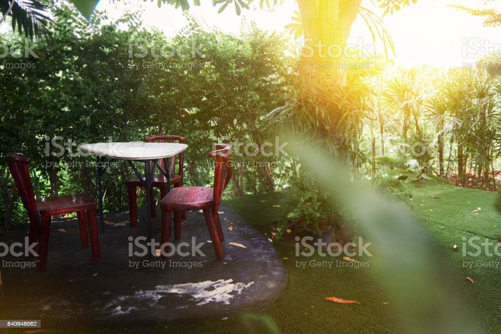 The restaurant table in a restaurant style restaurant and shady...