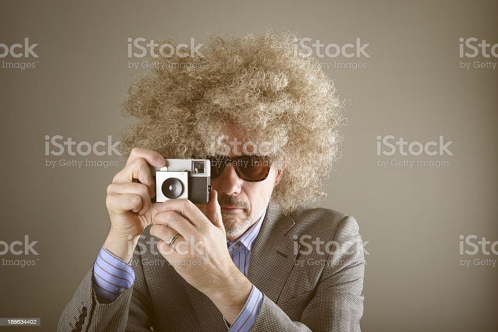 The Retro Photographer Takes a Shot royalty-free stock photo