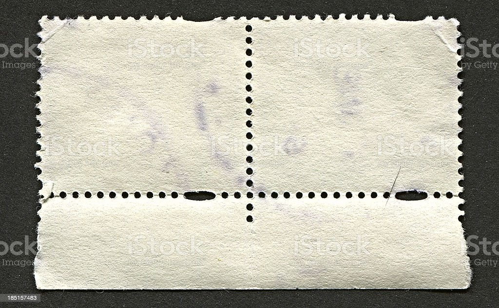 The reverse side of a postage stamp. royalty-free stock photo