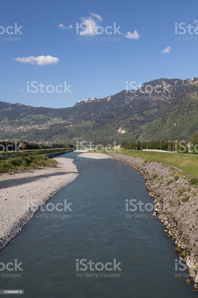 the rhine river between liechtenstein and the swiss stock photo