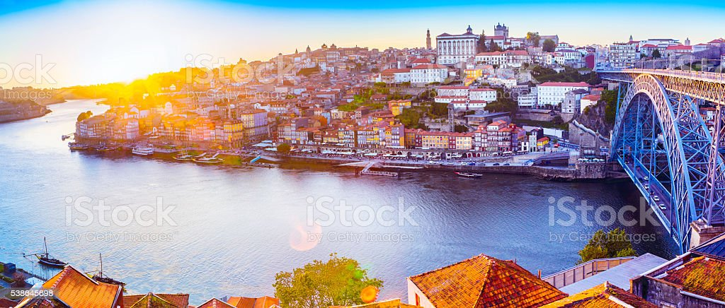 The Ribeira in Porto with a sunset and sunflare stock photo
