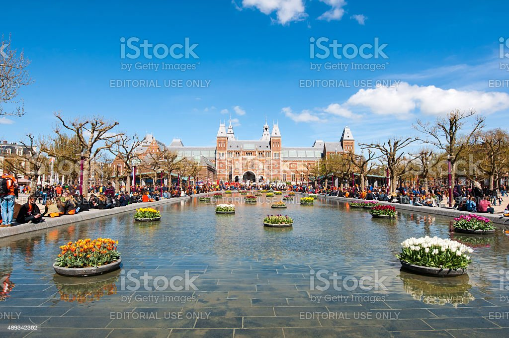 The Rijksmuseum from the Museumplein during King's Day. stock photo