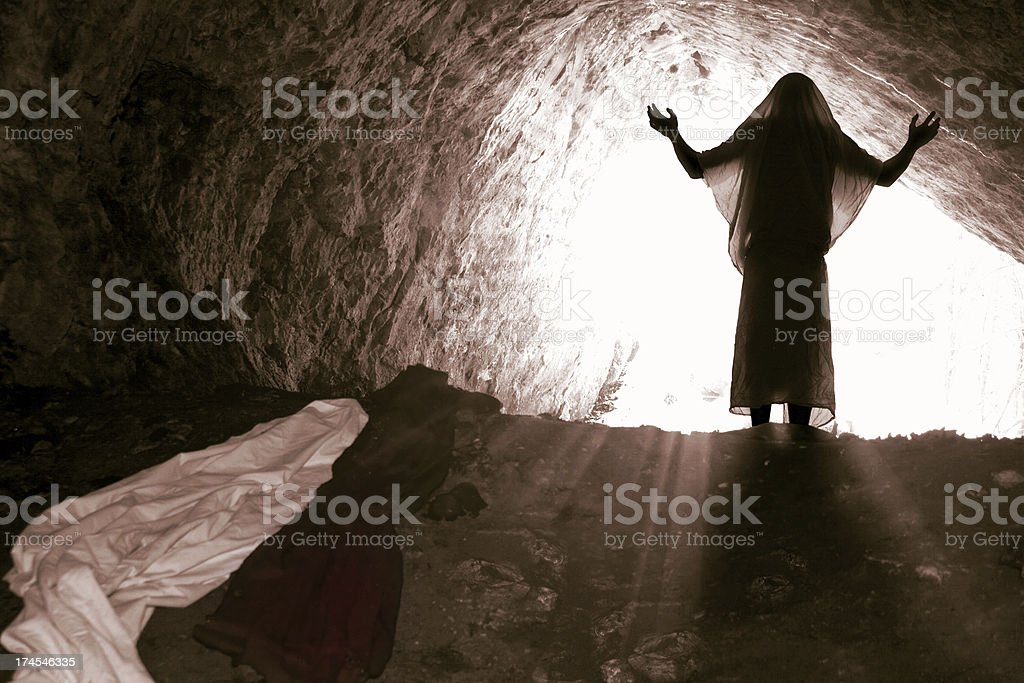 The risen Jesus comes out of the grave. stock photo