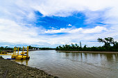 The river around the bend and sky clude background
