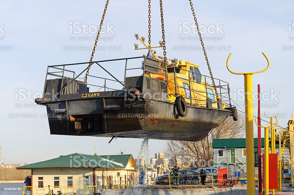 The river boat suspended from a chain slings. stock photo