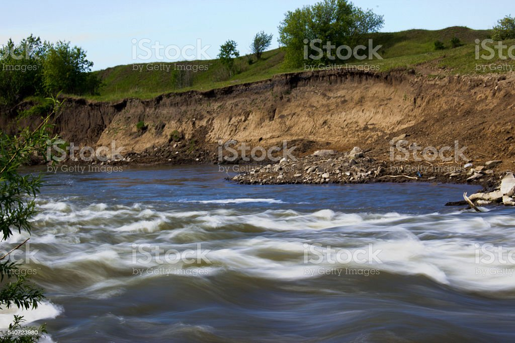 the river runs over the rocks royalty-free stock photo
