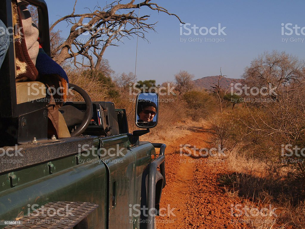 The Road ahead, driving through african bush. stock photo
