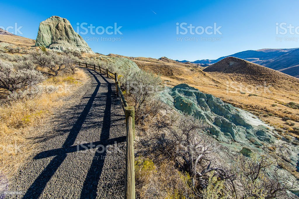 The road among the colorful hills. The unusual landscape. stock photo