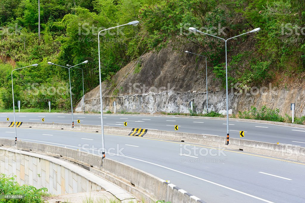 The road curves down the mountain stock photo