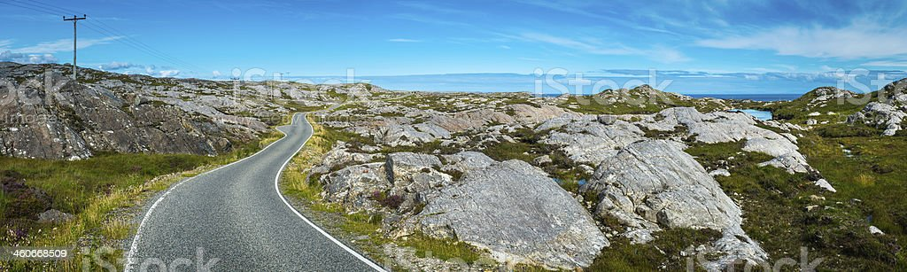 The road less travelled remote highway across idyllic island landscape royalty-free stock photo