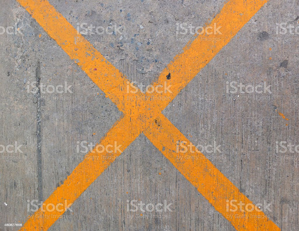 The road texture and Grunge yellow X letter stock photo