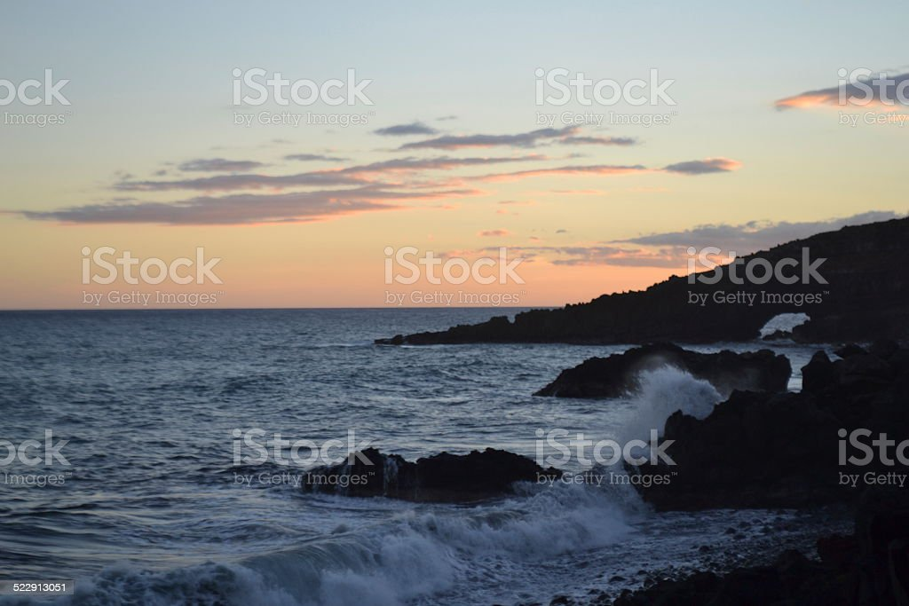 The Road to Hana...sunset on the rocks stock photo