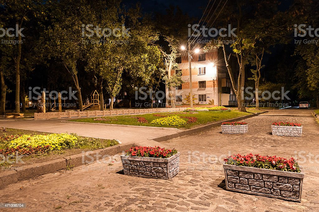 The road with flower beds in the evening stock photo
