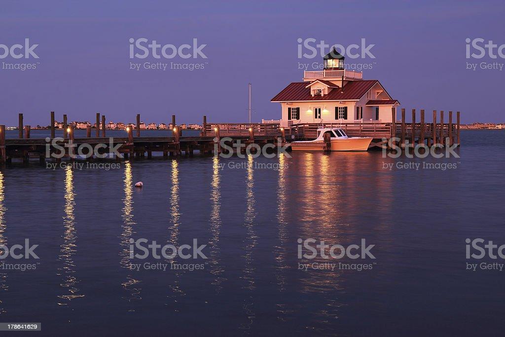 The Roanoke Marshes Lighthouse in Manteo, North Carolina, at dus stock photo