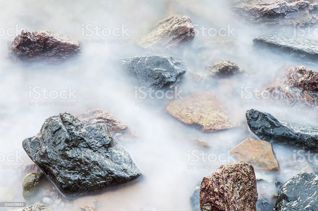 the rocks in the sea stock photo