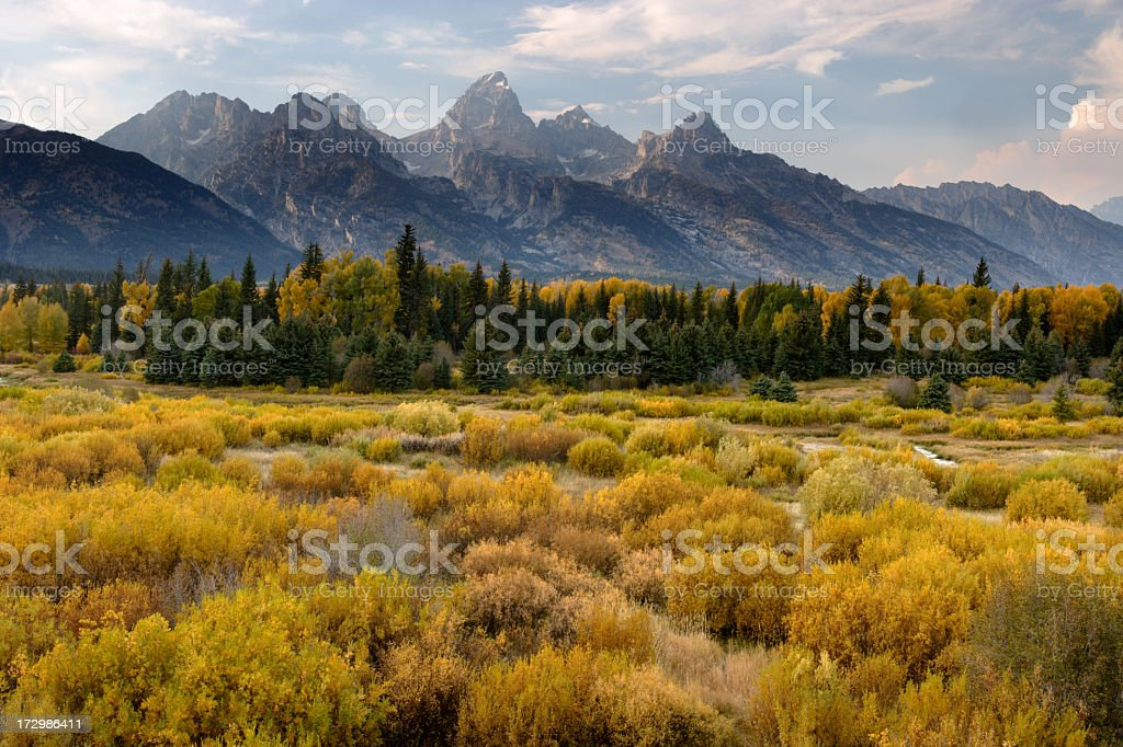 The Rocky Mountains and hills overlooking Tetons in the fall stock photo